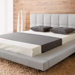 Modern and minimalist low profile platform bed design in grey with grey upholstered headboard