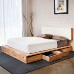Modern minimalist wood platform bed frame with storage and white headboard thick and cozy white bedding