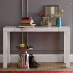 Modern white lacquer console table a pile of books