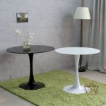 New Platinum Glass Round Ikea Tulip Table With Black And White Color On Green Fur Rug