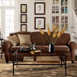 Pottery Barn Manhattan Sofa With Brown Design Color And Double Pillows Plus Glass On Top Coffee Table With Racks
