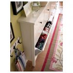 Pull out cabinet in white with shoe holder designed by IKEA