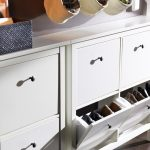 Pull out shoe holder on white cabinet