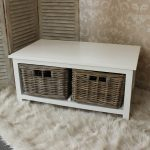 Pure white wooden coffee table with rustic look baskets