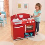 Red dominant kitchen toy in wood material