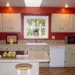 Red kitchen wall system white wall cabinets white colored ceiling mosaic kitchen backsplash white framed glass window white painted under cabinets white marble kitchen island