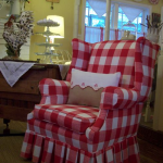 Red white buffalo upholstery slipcover for a reading chair