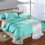 Reversable comforter idea with grey and turquoise color schemes