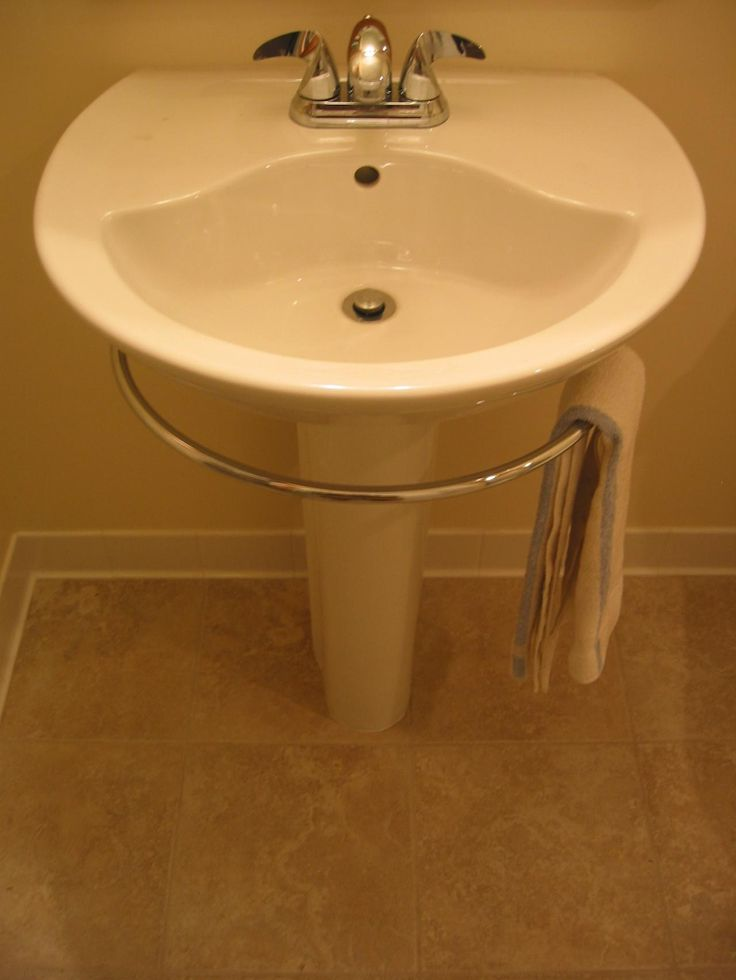 simple pedestal sink with towel bar and grey metal design