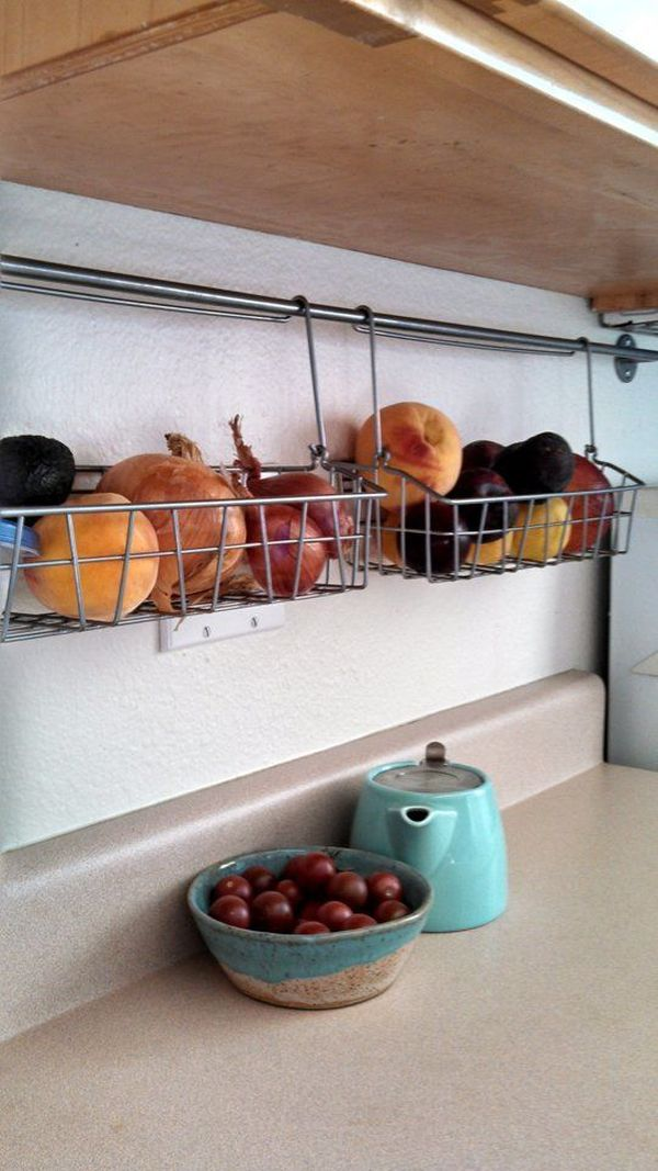 Simple Wire Wall Mounted Fruit Basket On Kitchen Wall