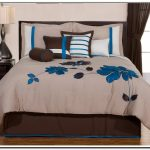Simple Bed Comforter Set In White With Blue Flower Pattern In King Size Black Bedside Table With Modern Table Lamp