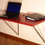 Simple fold desk with red top for computer