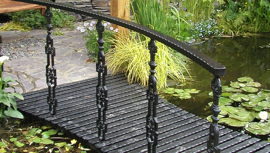 Simple Garden Bridge Made Of Metal Which Is Stained In Black And Only Has  One Side