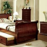 Single wooden Sleigh bed frame model with trundle and storage underneath in rustic scheme