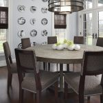 Small 8 Person Round Dining Table With Metal Design For Dark And Contemporary Dining Room Interior