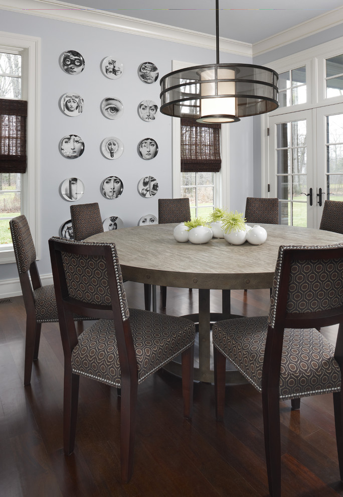 round dining table with metal design for dark and contemporary dining