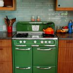 Small Green Antique Looking Stoves With Wooden Kitchen Set