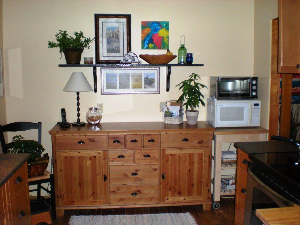 Small Wooden Microwave Stand Ikea At Corner Next To Cabinet In Kitchen