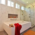 Square shaped bamboo rug for bathroom built in tub in white glass door shower space