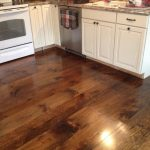Surprising Hardwood Floor VS Laminate For Kitchen With White Cabinet