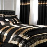 Thick and cozy black comforter with glossy gold stripe motif