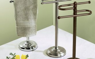 Three series of metal hand towel stands in dark, silver, and chrome color schemes