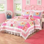 Toddler bed in full size with metal headboard and pink bed comforter set with flower patterns white corner chair