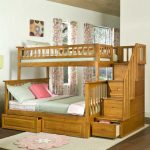 Toddler size loft bed with additional trundle storage and built in staircase