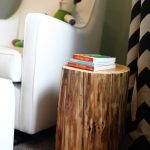 Tree trunk side table for nursery room a purely white nursery chair