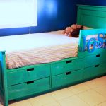 Turquoise wood bed frame with tall headboard side rail and under drawer system