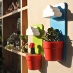 Two wall mounted pots with best potting soils for decorative plants
