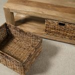 Unfinished wooden coffee table with baskets in rustic style