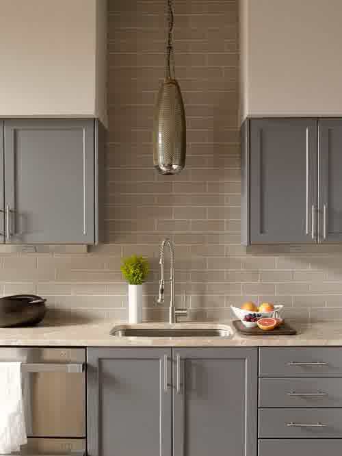 Over the sink lighting ideas homesfeed for Ceramic tile under kitchen cabinets