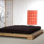 Very low platform bed in minimalist style black futon