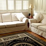 White Double Slipcovers For Leather Couches With Decoeative Rug And Shades On Window