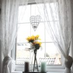 White Ikea Patterned Curtains With Flower On Window