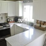 White Kitchen With Quartzite Countertops Pros and Cons And Classic Light