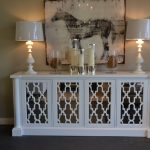 White Mirrored Media Console With Big Frame Candles And Double White Lamps