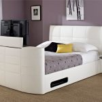 White Modern Beds With Built In TV WIth Storage And Unique Round Small Side Table