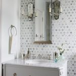 White Sink And Cabinet With Mirror On Ming Green Marble Tile