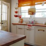 White Traditional Kitchen With Hanging Wall Mounted Fruit Basket