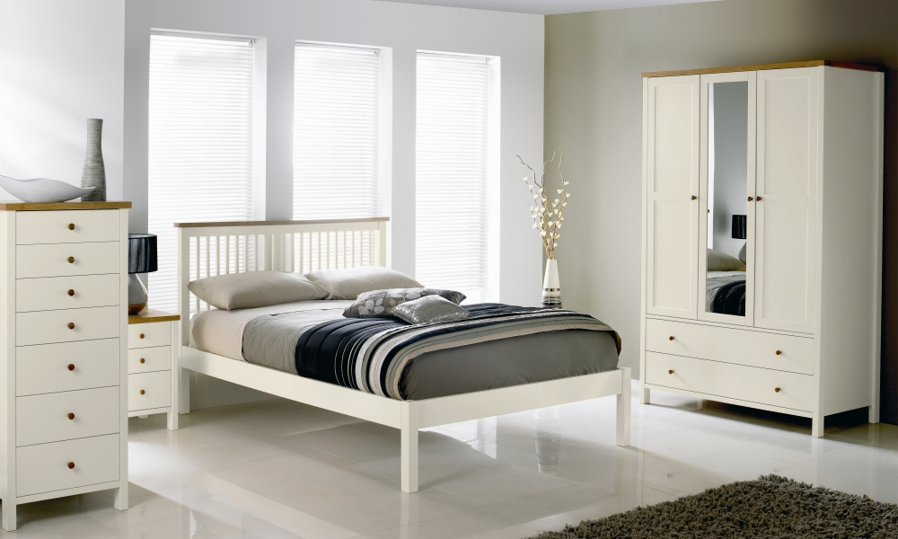 White minimalist bed frame with headboard a white cloth closet storage with mirror door a vertical drawer system in white white bedside table with drawers in white