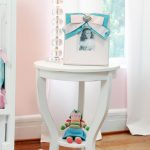 White round top nursery table with curly legs