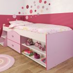 Wood toddler bed with storage in pink round pink bedroom rug