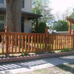 Wooden fencing system in natural brown finishing