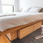Wooden platform bed frame with drawers underneath