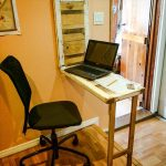 fold up wood computer desk in small size a black office chair
