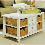 white finished wood coffee table idea with drawers and baskets
