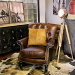 Brown Leather Reading Chair With Rustic Black Cabinet And Floor Lamp