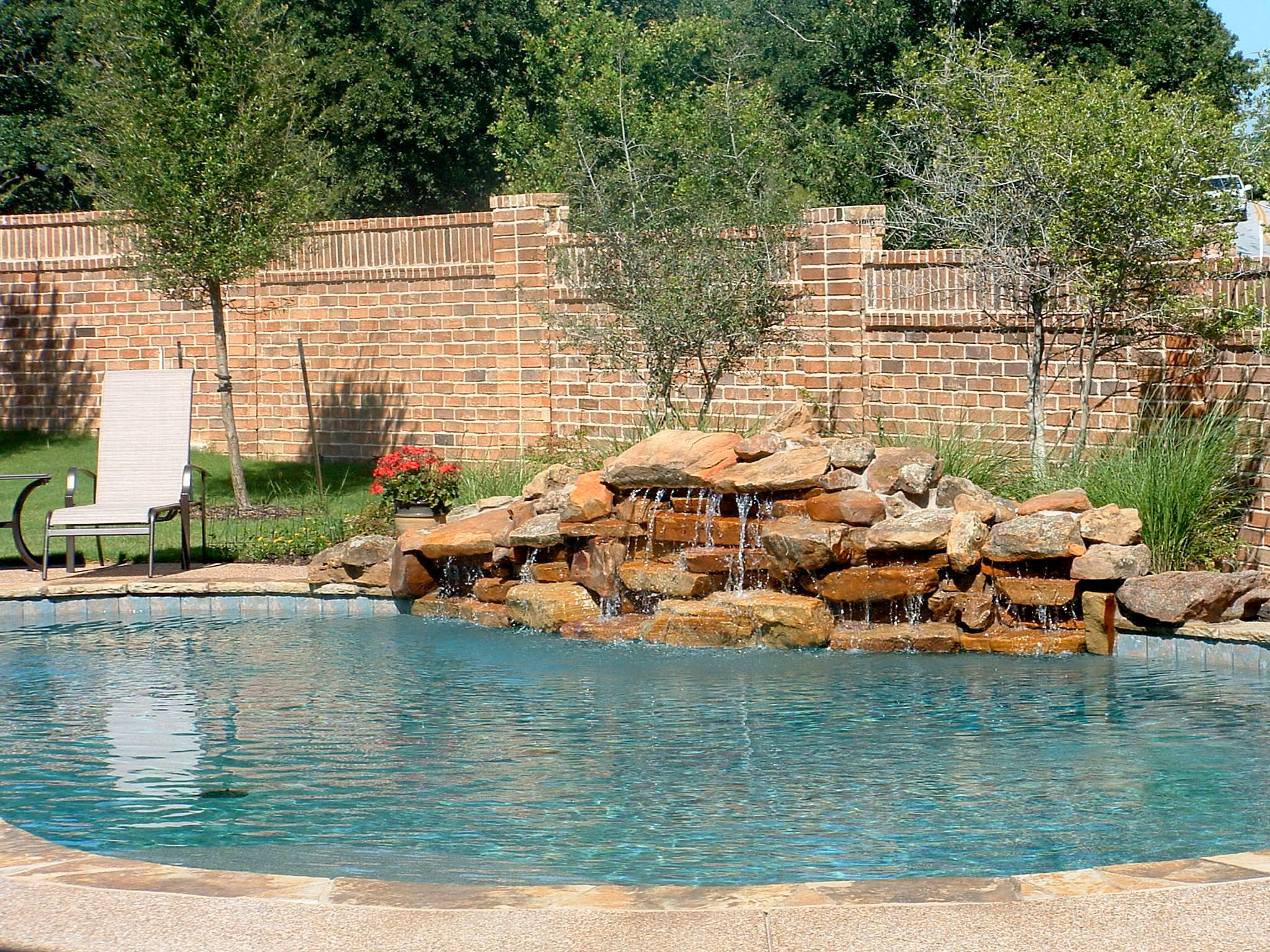 Building a natural swimming pool - Custome Natural Swimming Pool With Adorable Waterfall And White Chair